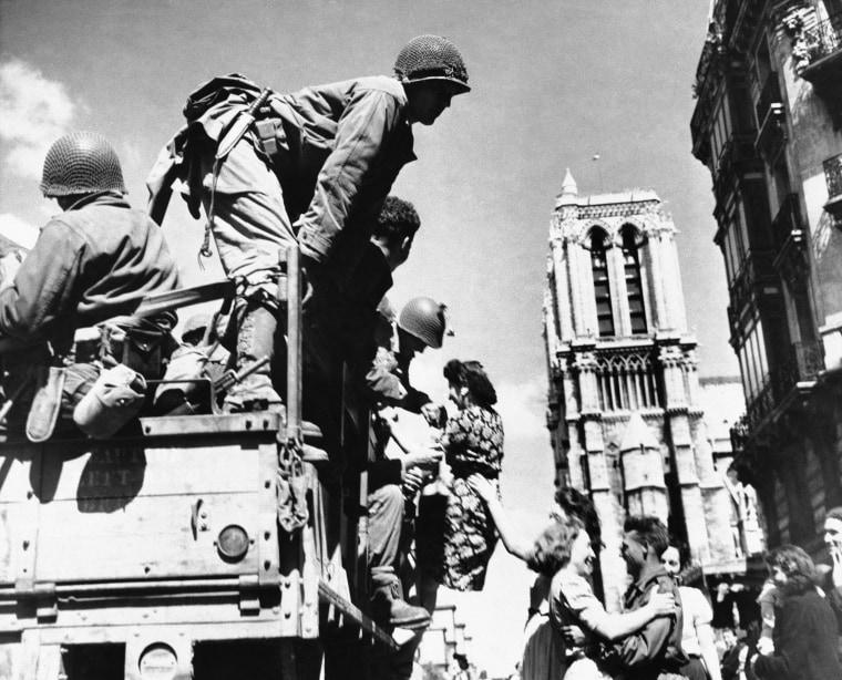 Image: U.S. soldiers are greeted by French women outside the Notre Dame on Aug. 28, 1944.