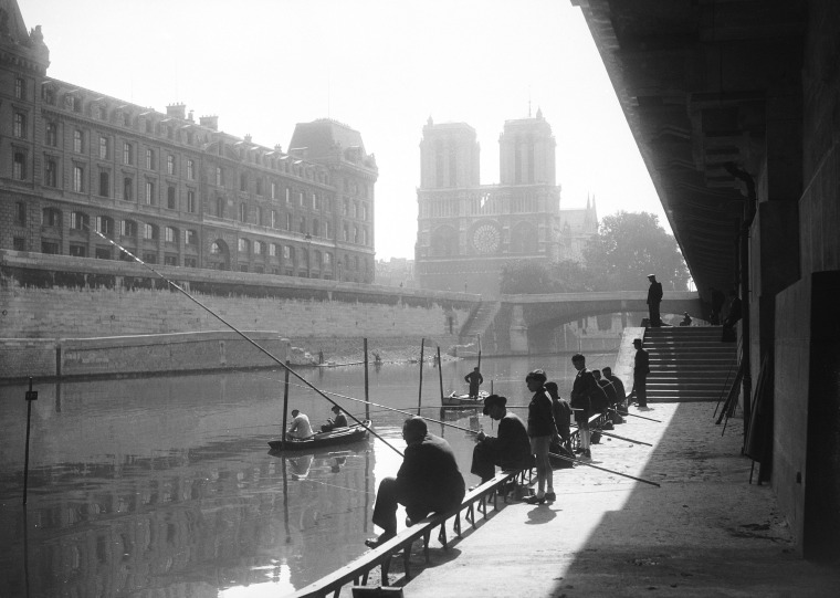 Image: After the liberation of Paris, Parisians fish at the Saint-Michel Quay near the Notre Dame on Sept. 27, 1944.