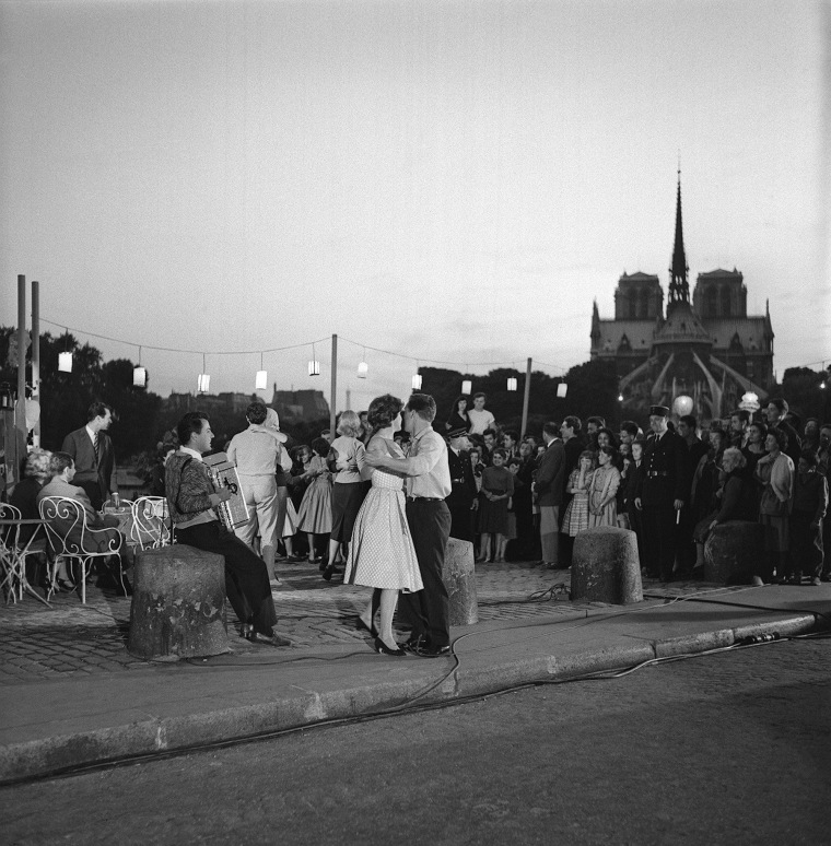 Image: A couple dances on the Saint Louis Island near the Notre Dame cathedral in 1958.