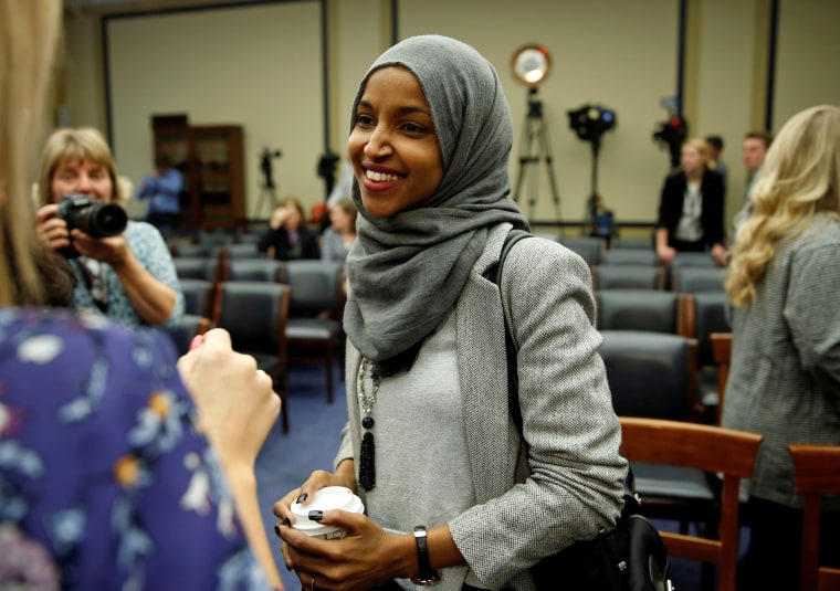 Image: FILE PHOTO: Representative-elect Ilhan Omar (D-MN) speaks to the media after a lottery for office assignments on Capitol Hill in Washington
