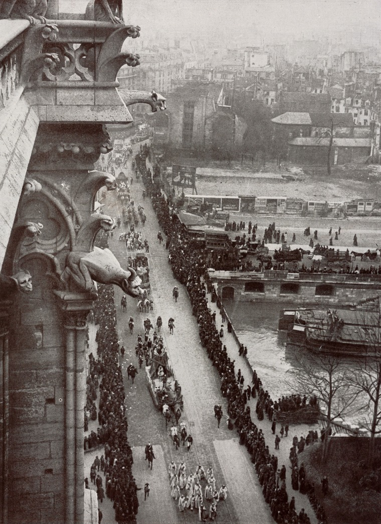 Image: Gargoyles look down on a carnival parade on March 12, 1910.