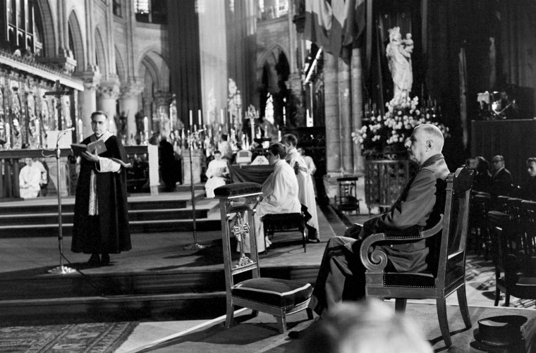 Image: French President Charles de Gaulle attends a mass for concentration camp victims at the cathedral in 1965.