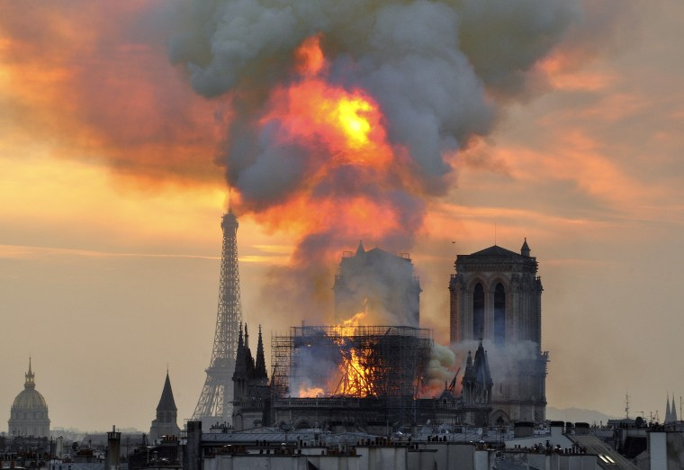 Image: Flames and smoke rise from Notre Dame in Paris on April 15, 2019.