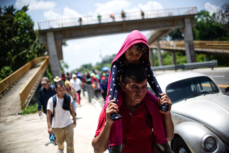 Image: Central American migrants traveling with a caravan rest on a road between Metapa and Tapachula in Mexico on April 12, 2019.