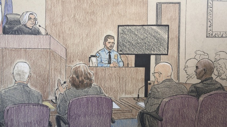 Minneapolis police officer Matthew Harrity, center, testifies Thursday  during the murder trial of former police officer Mohamed Noor, his former partner, who fatally shot an unarmed Australian woman, Justine Ruszczyk Damond in 2017, after she called 911 to report a possible sexual assault behind her home.