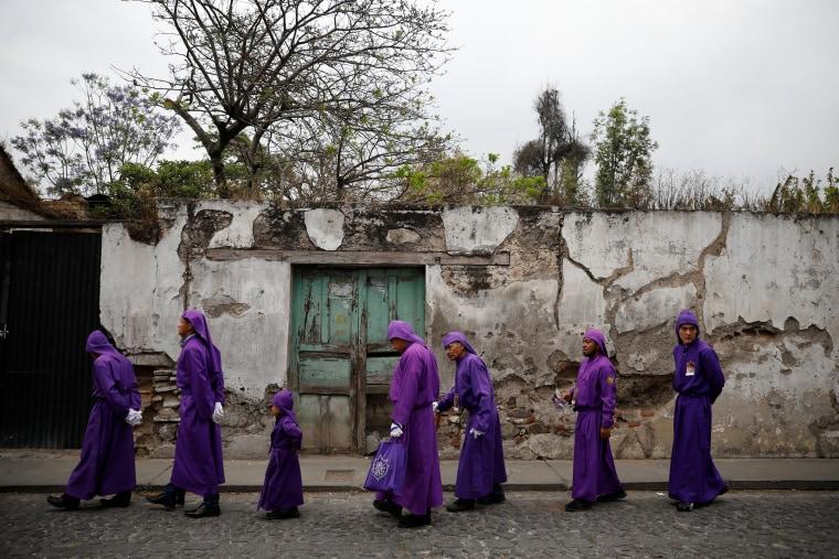 Image: Catholic faithfuls take part in the Procession of Jesus Nazareno de la Humildad during Easter celebrations in Antigua
