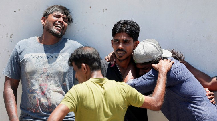 Image: Relatives of a victim killed in an explosion mourn near the police mortuary in Colombo, Sr Lanka, on April 21, 2019.