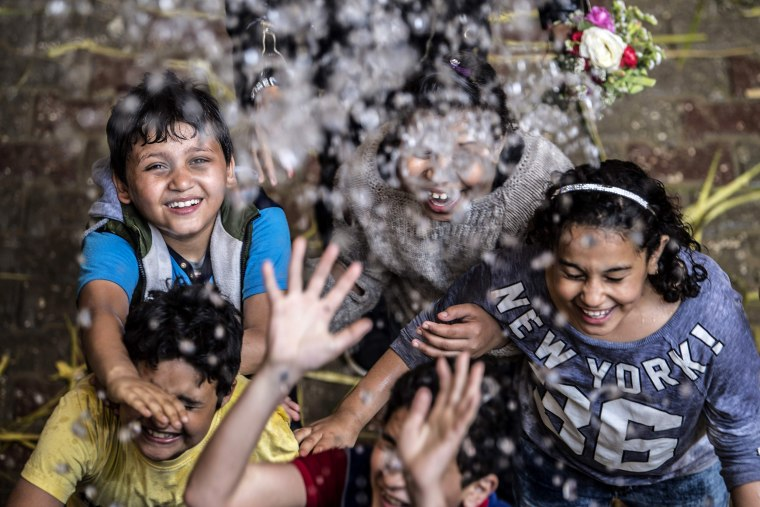 Image: Children are sprayed with holy water during Palm Sunday mass at the Saint Simon Church in Cairo, Egypt, on April 21, 2019.