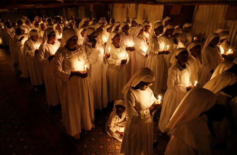Image: Devotees of the Legio Maria African Mission Church hold candles at Easter mass near Nairobi, Kenya, on April 20.
