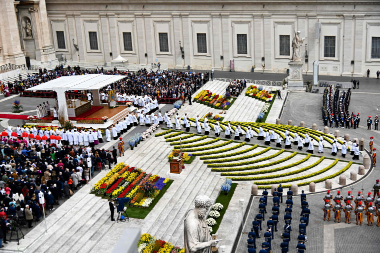 Image: St. Peter's Square is decorated with flowers as Pope Francis holds Easter mass at the Vatican on April 21.
