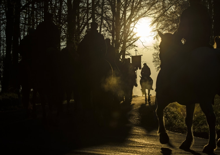 Image: Sorbs carry parish banners while riding horses during an Easter procession in Ostro, Germany, on April 21.