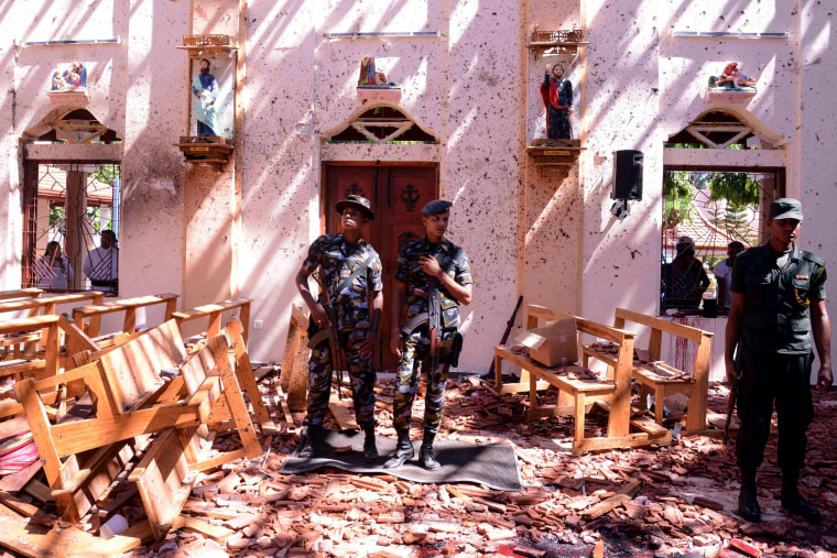 Image: Sri Lankan soldiers stand watch after a bombing at St. Sebastian's Church in Negombo on April 21, 2019.