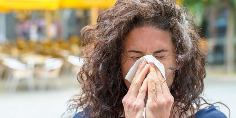 Woman Sneezing Outdoors