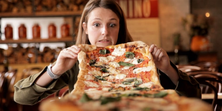 This larger than life pizza is absolutely insane.