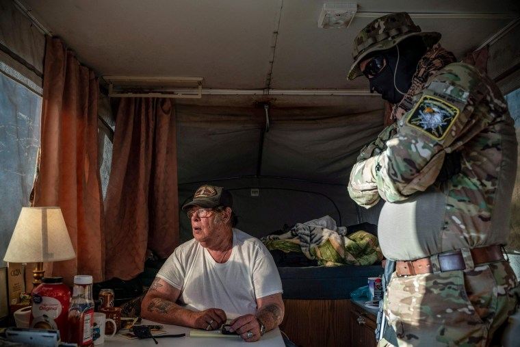 Image: Striker, the leader of the Constitutional Patriots militia, speaks with Viper, right, about logistics in Anapra, New Mexico, on March 20, 2019.