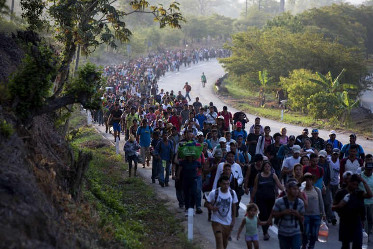 Image: Central American migrants walk down a road in Escuintla in Chiapas State, Mexico, on April 20, 2019.