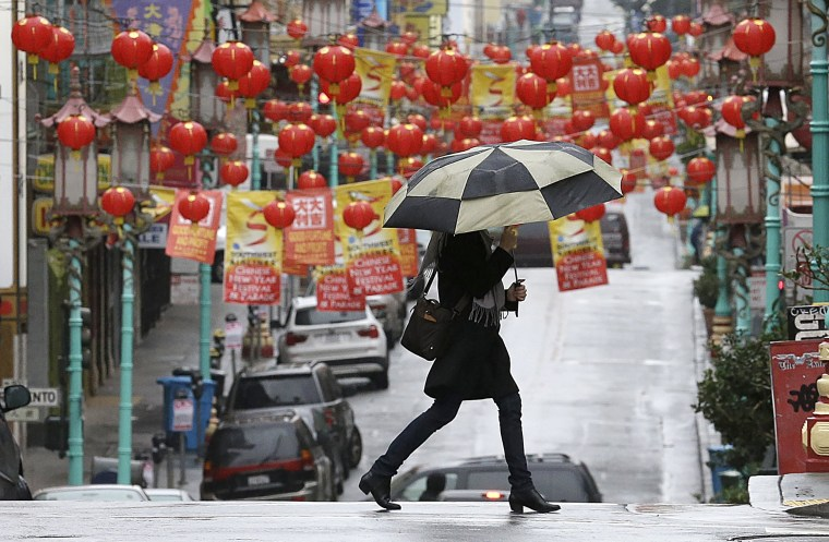 Image: Woman carries umbrella in San Franisco, Chinatown