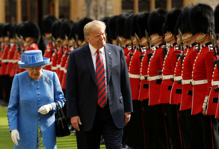 Image: Queen Elizabeth and President Donald Trump inspect the guard of honor at Windsor Castle in England on July 13, 2018.