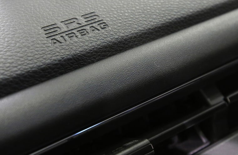 Image: An airbag logo on a dashboard of a Honda Motor Co's car displayed at the company's showroom.
