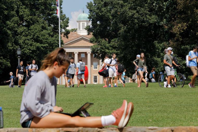 Image: Students walk through the campus of the University of North Carolina at Chapel Hill North Carolina