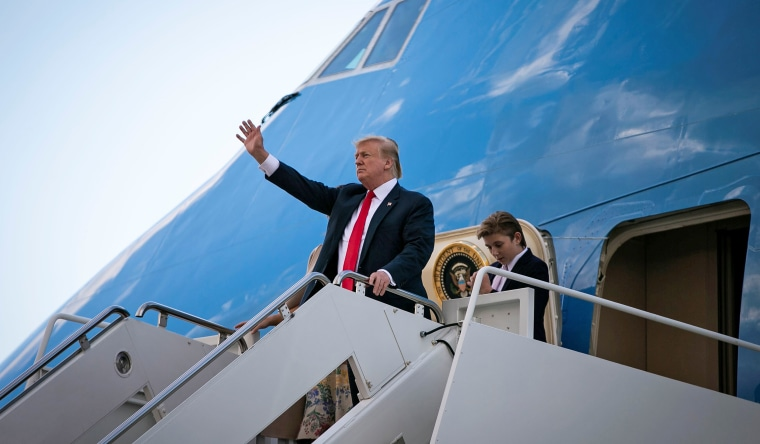 Image: U.S. President Donald Trump and U.S. first lady Melania Trump arrive aboard Air Force One