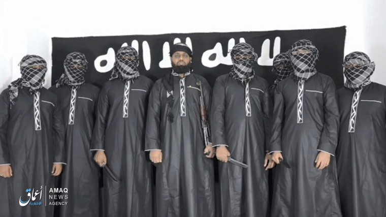 Image: A screengrab from a video posted by the Islamic State group's Aamaq information arm on Tuesday, April 23, 2019, purports to show Mohammed Zahran, a.k.a. Zahran Hashmi, center, the man Sri Lanka says led the Easter attack that killed over 300 people