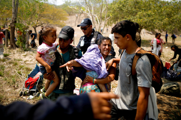Image: A migrant family is detained by police during a raid in Pijijiapan, Mexico, on April 22, 2019.