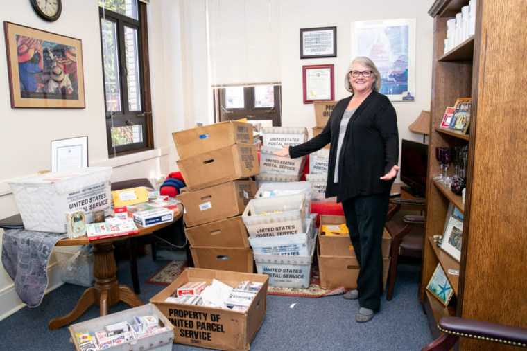 Image: Washington State Sen. Maureen Walsh and the decks of playing cards she's received in the mail in Olympia on April 23, 2019.
