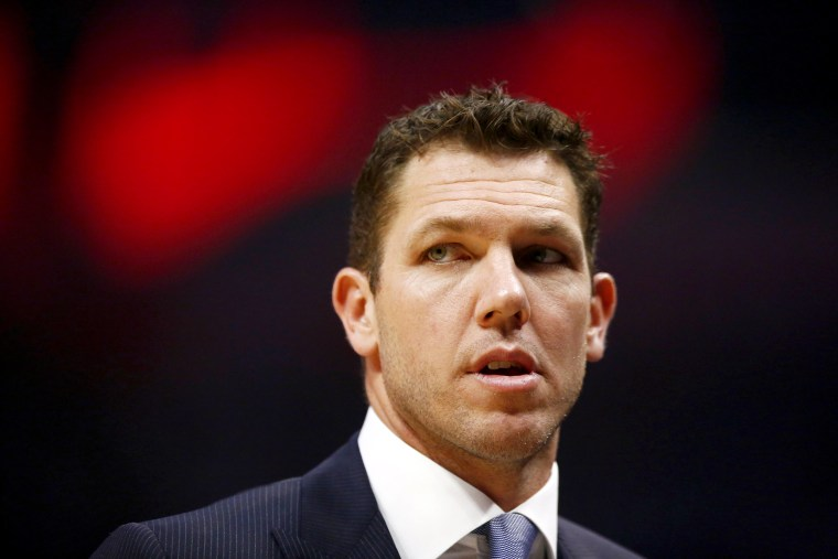 Image: Luke Walton looks on during a game at the Staples Center in Los Angeles on April 5, 2019.