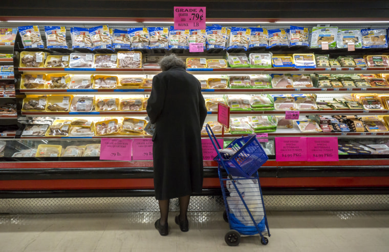Image: A woman shops for chicken at a supermarket in New York on March 8, 2016.