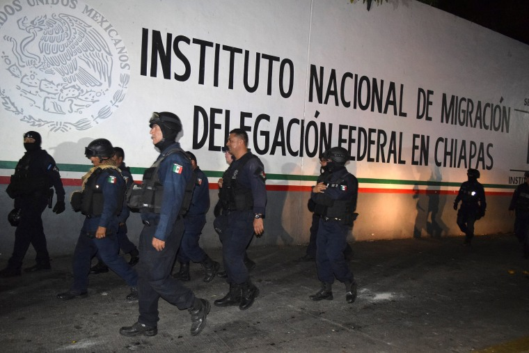 Image: Policemen outside the Siglo XXI immigrant detention center in Tapachula