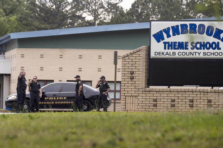 Image: DeKalb County District police investigate a BB gun shooting at Wynbrooke Elementary School in Stone Mountain,