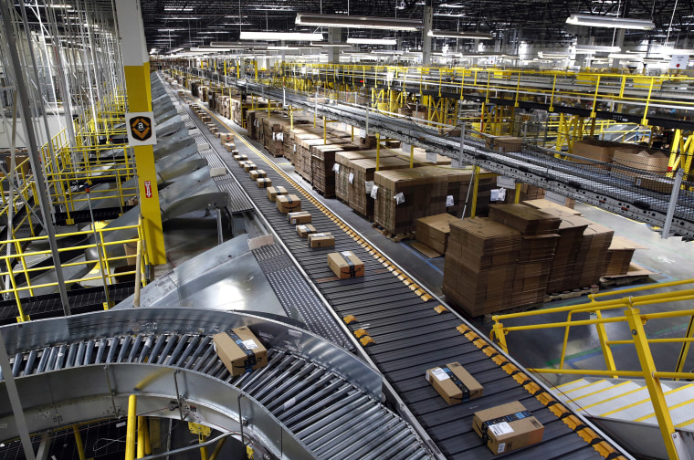 Image: Packages ride on a conveyor system at an Amazon fulfillment center in Baltimore
