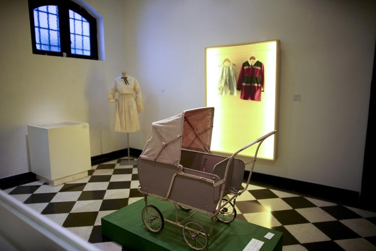 """Image: A toy baby carriage of the \""""Childhood and Peronism, the toys of the Eva Per?n Foundation\"""" exhibit is displayed at the Evita Museum in Buenos Aires, Argentina"""