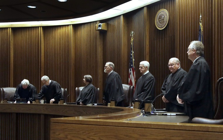 Kansas Supreme Court justices take there seats before hearing arguments in a case in Topeka, Kansas on May 22, 2018.