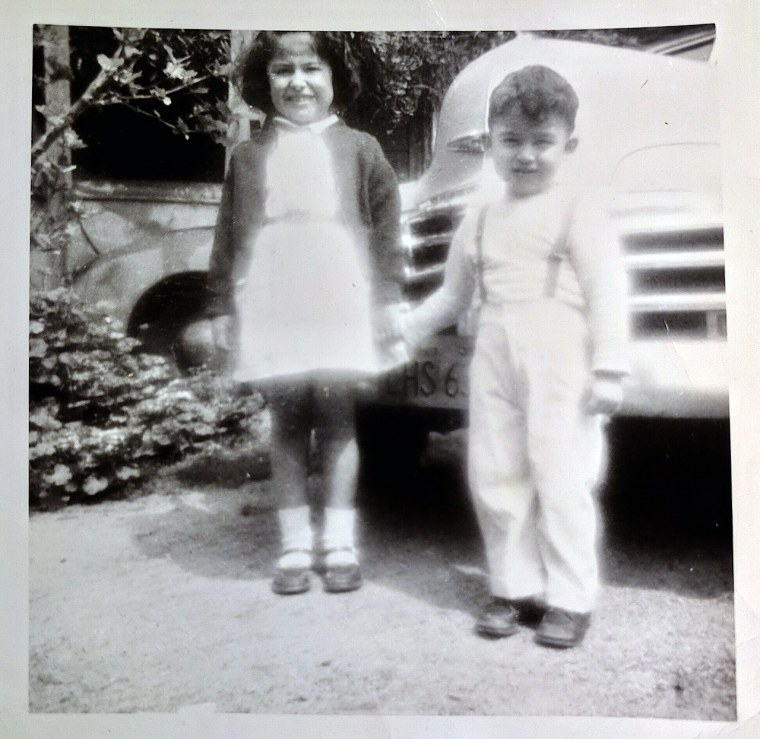 Louie Perez with his sister Carmen, courtesy of Louie Perez. This photo inspired several paintings in Perez's book Good Morning Aztlan