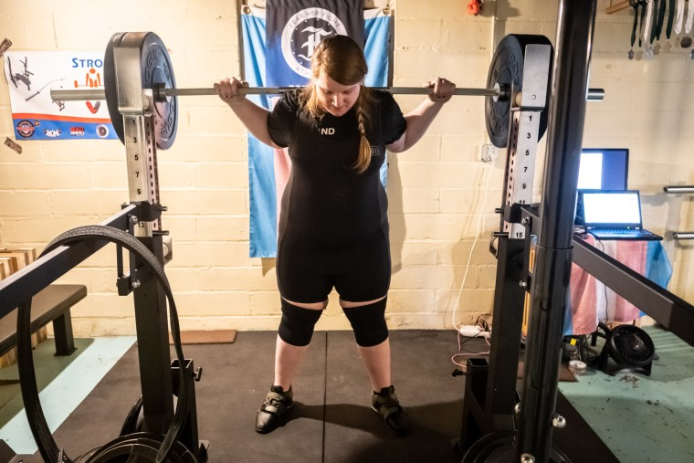 Photograph of JayCee Cooper lifting.