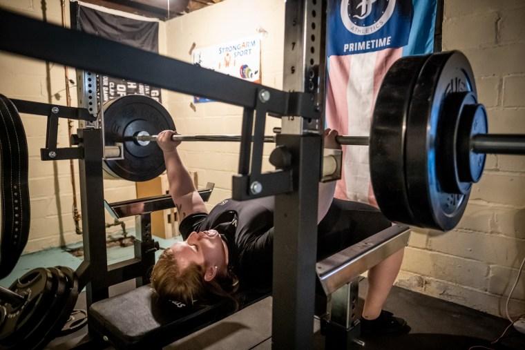 Photograph of JayCee Cooper lifting.
