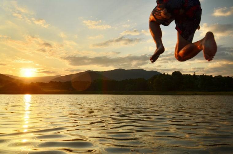 Image: Man jumping into lake