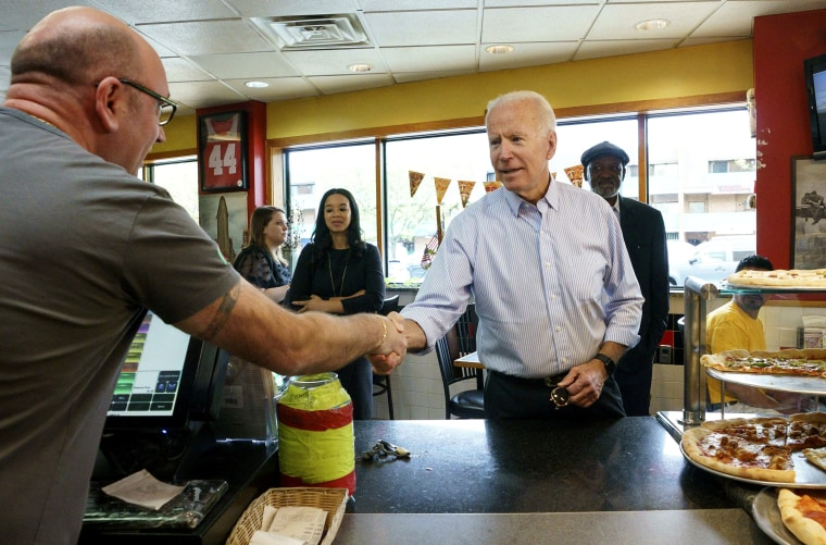 Image: Joe Biden greets people at Gianni's Pizza in Wilmington, Delaware, on April 25, 2019.