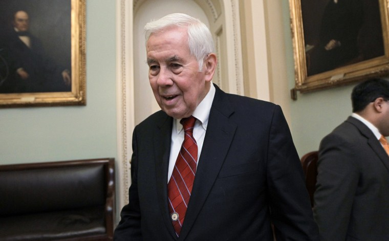 Image: Sen. Richard Lugar, R-Ind., leaves the Senate floor at the Capitol in 2011.