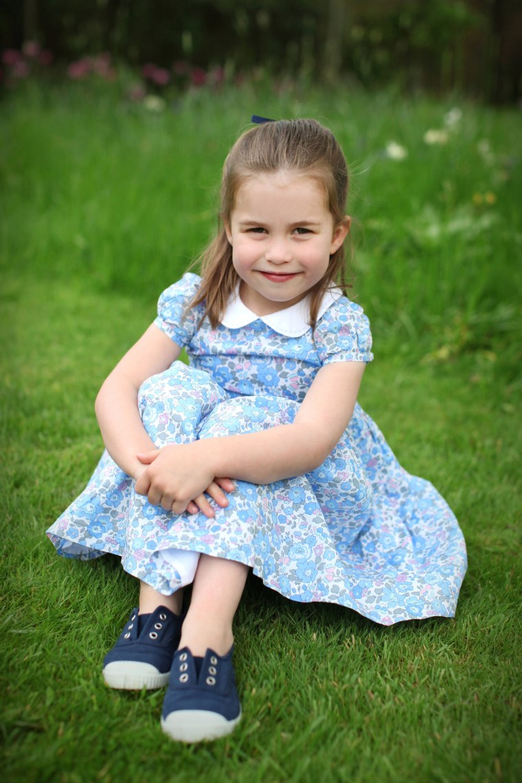5acde1977 Princess Charlotte wearing George's shoes in a photo for her 4th birthday