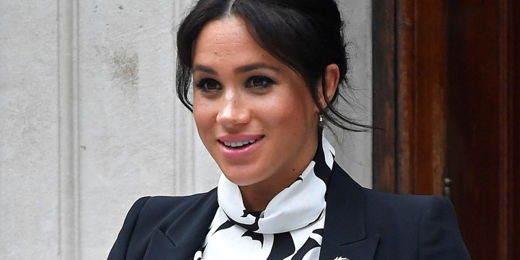 Image: Britain's Meghan, Duchess of Sussex, leaves after an International Women's Day panel discussion at King's College London