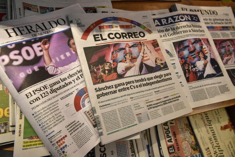 Image: Spanish newspapers in Pamplona, northern Spain, announce the victory of Spain's Prime Minister and candidate of the Spanish Socialist Party, Pedro Sanchez, a day after general elections