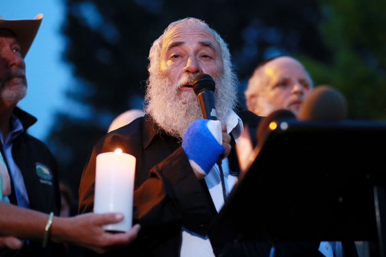 Image: Rabbi Yisroel Goldstein speaks to community members and congregants about the shooting at the Chabad of Poway Synagogue during a candlelight vigil for the victim of the Chabad of Poway Synagogue at Valle Verde Park