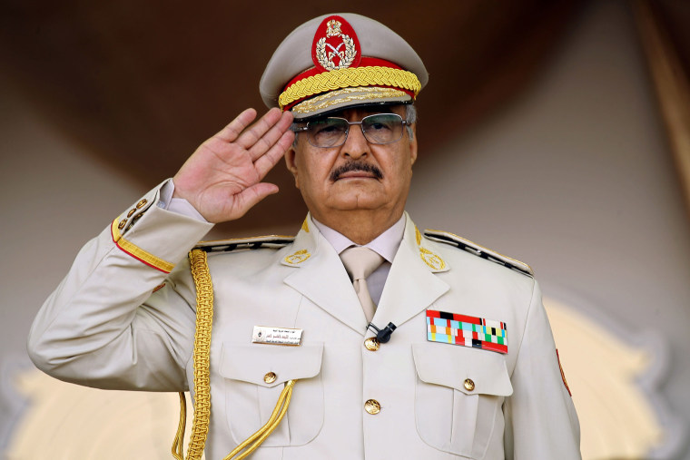 Image: Libyan Strongman Khalifa Haftar salutes during a military parade in the eastern city of Benghazi