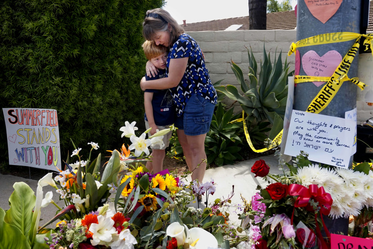 Image: Heather Foy and her son, Marshall, embrace at a memorial near the Chabad synagogue in Poway, California, on April 28, 2019.