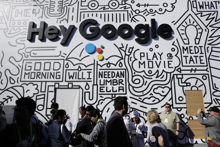 People wait in line to enter the Google booth at CES International in Las Vegas