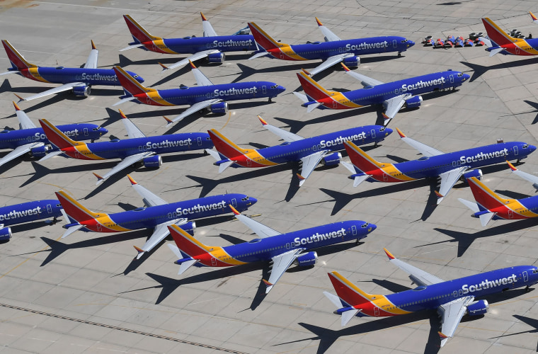 Image: Southwest Airlines Boeing 737 MAX aircraft are parked on the tarmac after being grounded at the Southern California Logistics Airport in Victorville, California