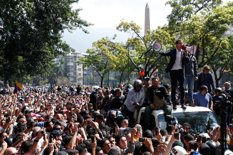 Image: Venezuelan opposition leader Juan Guaido, who many nations have recognised as the country's rightful interim ruler, talks to supporters in Caracas